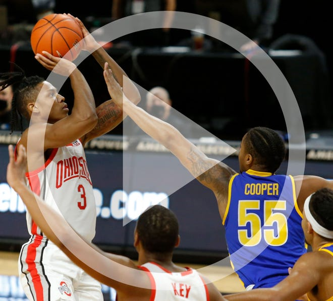 In this file photo, Ohio State guard Eugene Brown, left, goes up for a shot against Morehead State guard Ta'lon Cooper (55) during the first half of an NCAA college basketball game in Columbus, Ohio, Wednesday, Dec. 2, 2020.