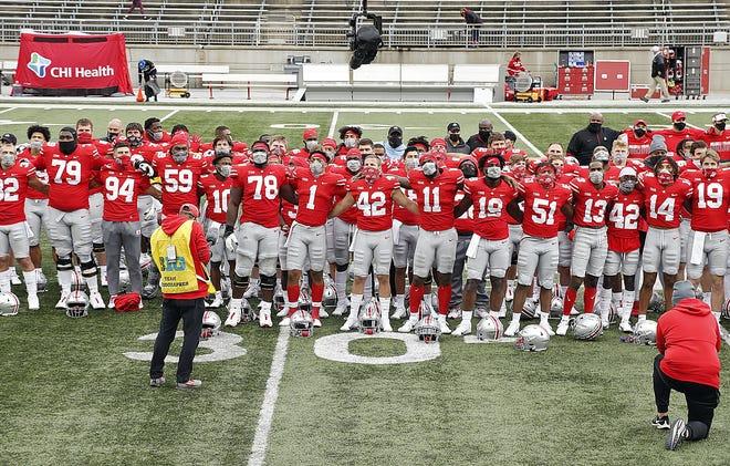 "Ohio State football players sing ""Carmen Ohio"" after the season-opening win against Nebraska."