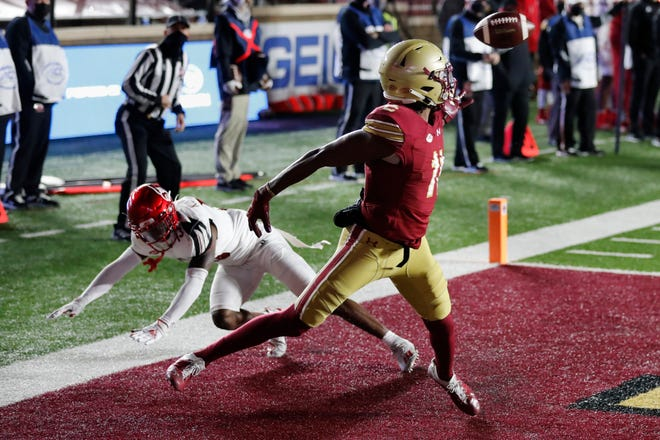 Boston College wide receiver CJ Lewis makes a touchdown reception against Louisville cornerback Kei'Trel Clark last Saturday.