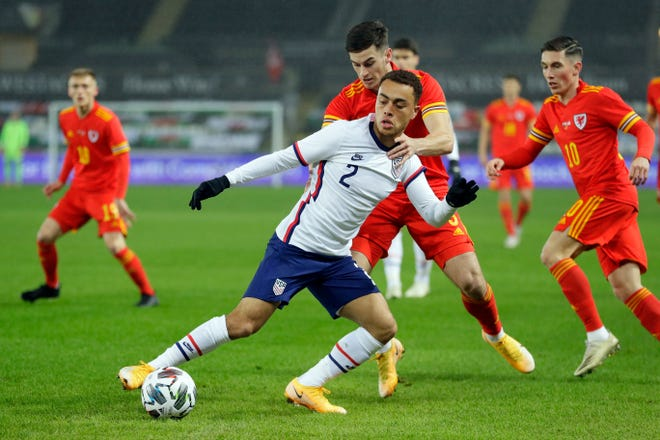 Sergiño Dest of the United States controls the ball as Tom Lawrence of Wales tries to stop him during the international friendly match at Liberty stadium in Wales on Nov. 12.