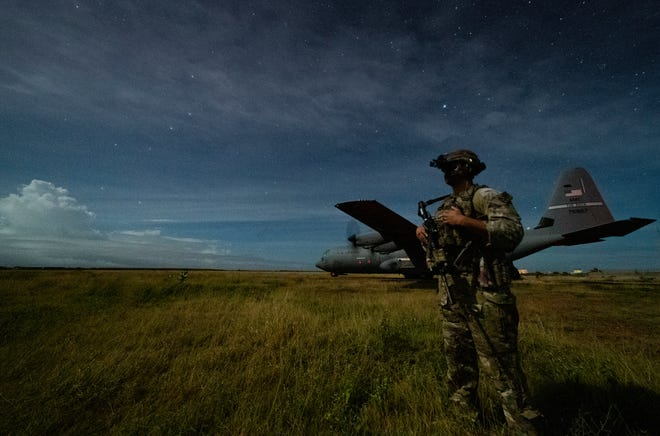 U.S. Army Spc. Kevin Martin, a junior sniper, assigned to the 1-186th Infantry Battalion, Task Force Guardian, provides security June 28 for a C-130J Super Hercules in Somalia.