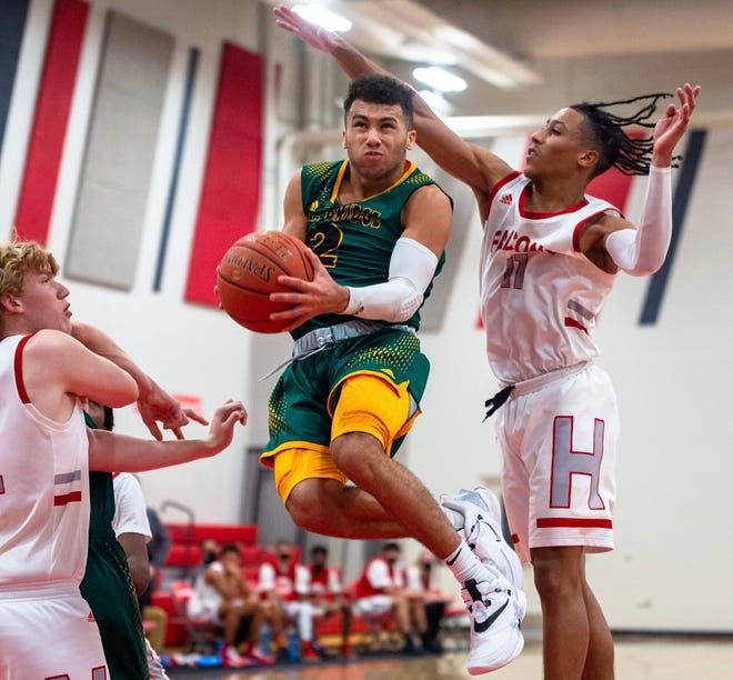 Rock Bridge's Xavier Sykes (2) goes airborne toward the basket during a game against Van Horn on Thursday in Independence.