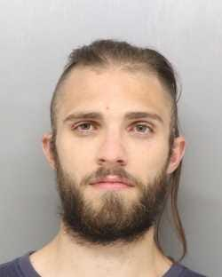 Merak Burr, 25, refused police orders in December when he was stopped on I-71 in Delaware County. A gun was on his car seat.