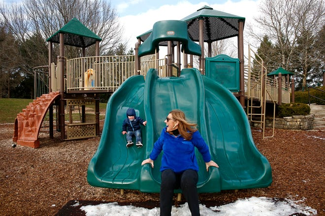 Metro Parks plans to spend $1 million next year to thoroughly upgrade Homestead Park, a popular park in Hilliard for families. Margo Izzo, right, of Dublin, goes down the slide with her grandson, Griffin Kurtz, 18 months, left, on one of the playgrounds at Homestead Park on Friday.
