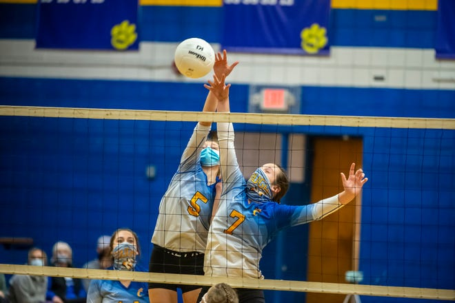 Southwestern Randolph's Josie Allred and Molly Strider block the ball against Asheboro in cross town volleyball action on Thursday.