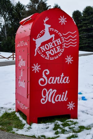 A bright red Santa Mail mailbox sits is Byesville, ready to receive kids' and adults' letters to Santa Claus.