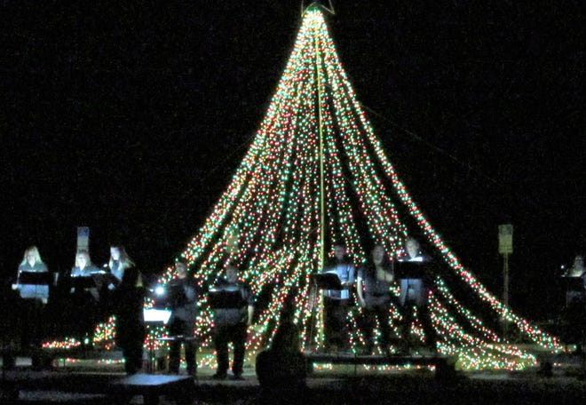 Singers dazzle with vocal performances during the Tree of Lights celebration, presented by The Green Room Farm-to-Table Dinner Theatre, on Thursday evening at the Florida Agricultural Museum.
