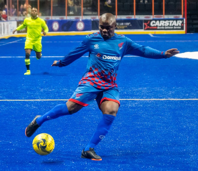 With Milwaukee's Ian Bennett, left, trailing, Comets player/coach Leo Gibson takes a shot on goal in an MASL playoff game against the Wave in 2019. Gibson, as the player coach, will be teammates with Bennett on the East squad as the Comets host the MASL All-Star game Saturday at Cable Dahmer Arena in Independence.