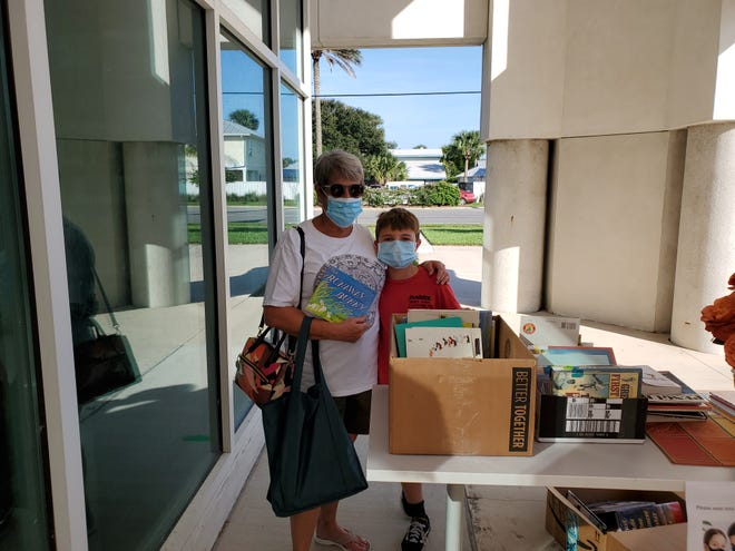 Book lovers browse through the selection during last month's pop-up book sale at the Beaches Branch Library in Neptune Beach. The library will host another pop-up sale Saturday, Dec. 12, from 1 to 4 p.m.