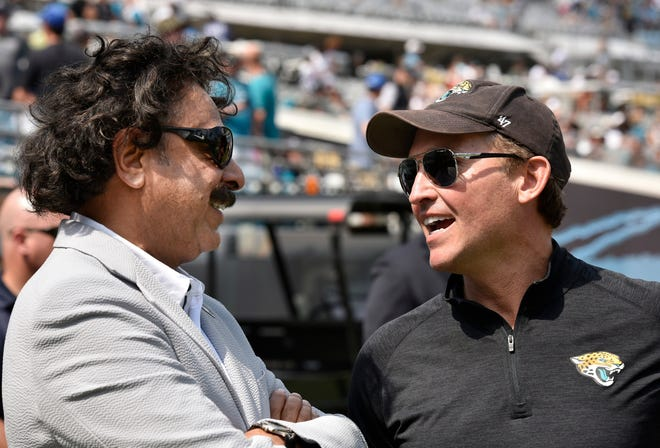 Jaguars owner Shad Khan (left) and Mayor Lenny Curry chat as they wait on the sidelines at TIAA Bank Field on September 17, 2017.