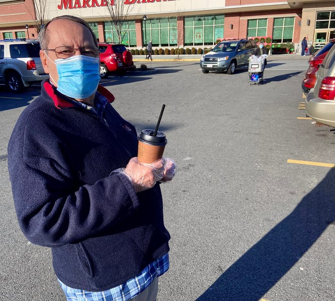 Paulo Rib of Tiverton, seen here wearing disposable gloves, says some people apparently haven't gotten the message about wearing face masks in public.