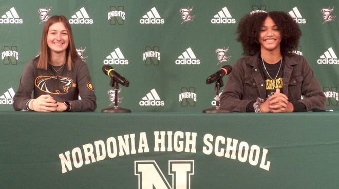 Nordonia seniors Hallie Majoros, left, and Joy Banks signed their national letters of intent Dec. 4 at Nordonia. Majoros will play basketball at the University of Milwaukee-Wisconsin, while Banks will play volleyball at Northern Kentucky University.