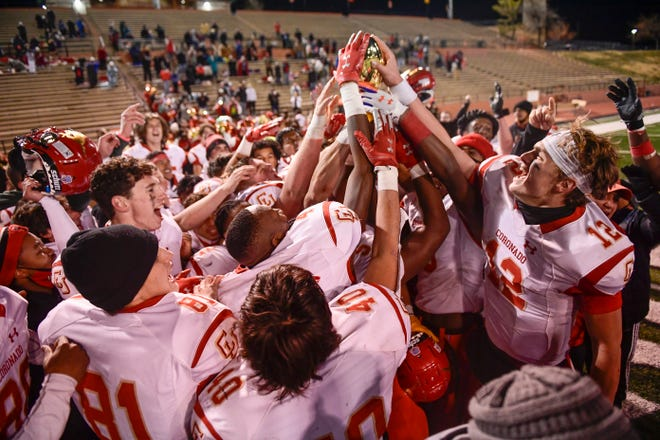 Coronado celebrates winning the District 2-5A Division I championship against Tascosa on Thursday at Dick Bivins Stadium in Amarillo. The Mustangs finished the season 10-0, 6-0.