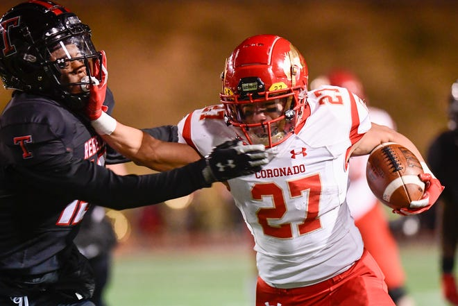 Coronado's Eli Martinez (27) runs the ball during a District 2-5A Divison I game Dec. 3 against Tascosa at Dick Bivens Stadium in Amarillo. The Mustangs defeated the Tascosa to claim the district title.