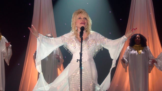 "This image released by CBS shows Dolly Parton in a scene from her holiday special, ""A Holly Dolly Christmas,"" airing Sunday, Dec. 6 on CBS."