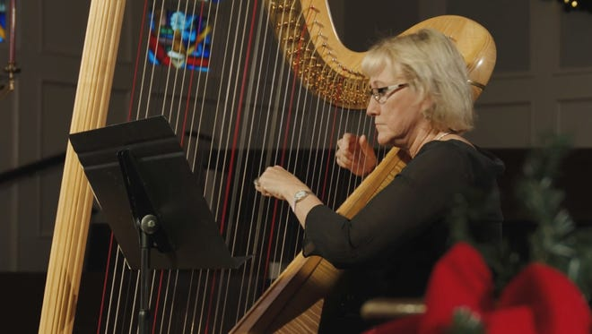 """Dolly Roberts, a Tampa-based harpist, performs in First Presbyterian Church's """"Glory of Christmas"""" concert. The Lakeland church is presenting a recorded version of the event this year rather than the traditional live concert."""