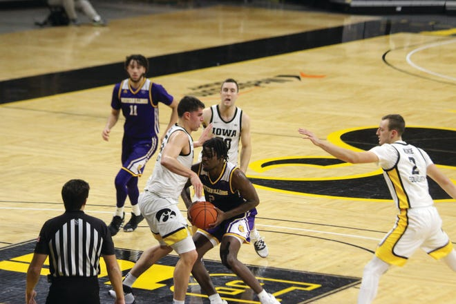 Western Illinois' Tamell Pearson goes to the basket during Thursday's game at Iowa.