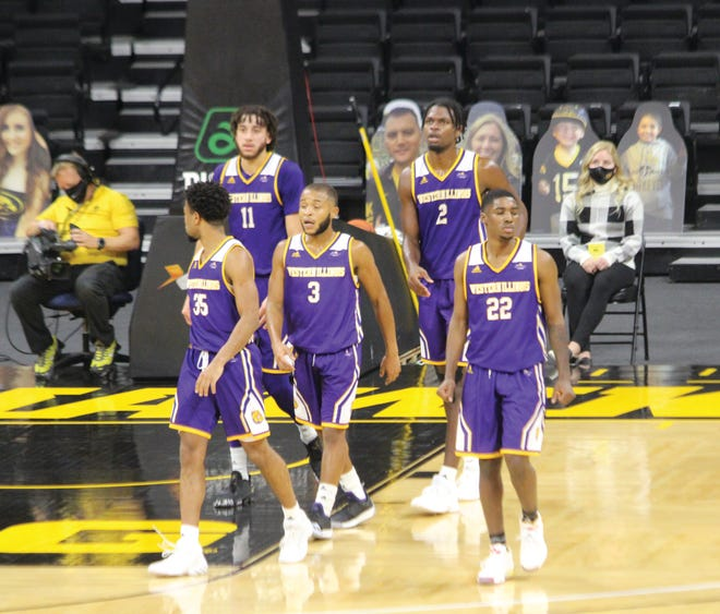 Members of the Western Illinois men's basketball team take the floor Thursday night at Iowa.