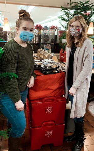 Spoon River College Student Ambassadors Maggie Eveland and Faith Haley spent a part of their Thanksgiving Day giving back to the community by volunteering at the Salvation Army in Canton. Eveland and Haley are pictured together, and Eveland is also pictured with Captain Sarah Eddy.