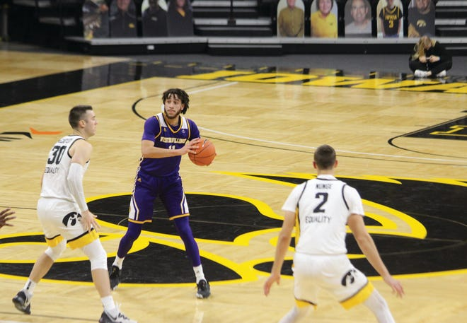 Western Illinois' Rod Johnson Jr. holds the ball during Thursday's game at Iowa.