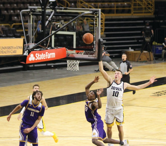 Western Illinois' Marcus Watson Jr. goes up for a basket during Thursday's game at Iowa.
