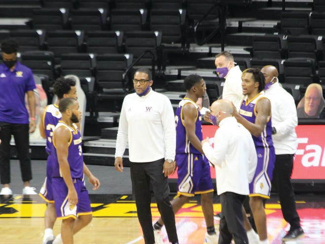 Western Illinois coach Rob Jeter encourages his team during a timeout.