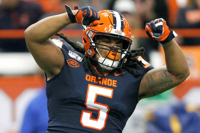 """Syracuse's Chris Elmore celebrates after making a tackle during an Oct. 2019 game. Syracuse coach Dino Babers calls Elmore """"unselfish."""