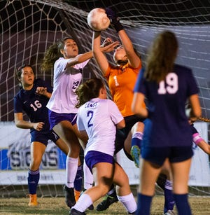 Vanguard keeper Gianna Meccia makes a save in the second half. The Vanguard Knights defeated the Gainesville Hurricanes 3-0 Thursday night.