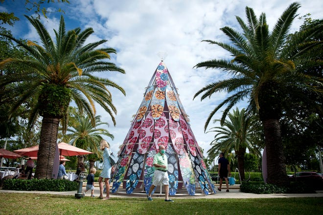 Artist Ashley Longshore's work adorns The Royal Poinciana Plaza's annual surfboard Christmas tree and holiday decor though out the property December 4, 2020 in Palm Beach. The New Orleans based artist will be at the nook by Celis Produce Saturday to sign books between 1 p.m. and 2 p.m. [MEGHAN MCCARTHY/palmbeachdailynews.com]