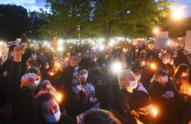 """Over 1,000 people showed up at Henry Law Park in Dover for Project DREAM's candlelight vigil for George Floyd aimed at stopping the """"violence of police brutality against innocent Black lives."""" [Deb Cram/Fosters.com]"""