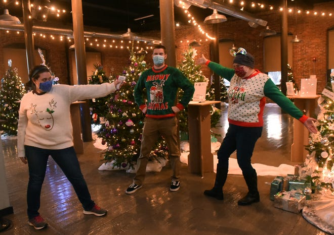 Greater Dover Chamber of Commerce staff wear their fabulous holiday sweaters as the Festival of Trees fundraiser kicks off Friday. From left are Melissa Launder, Morgan Faustino and Margaret Joyce, the chamber president.
