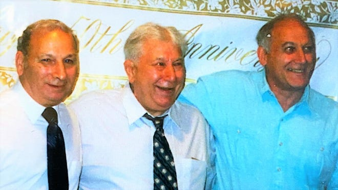 Ernie, left, Albert, and Tony Bastianelli are pictured in 1997 celebrating the 50th wedding anniversary of Ernie and his wife Agnes. All three were all-state running backs in football for Dover High School.