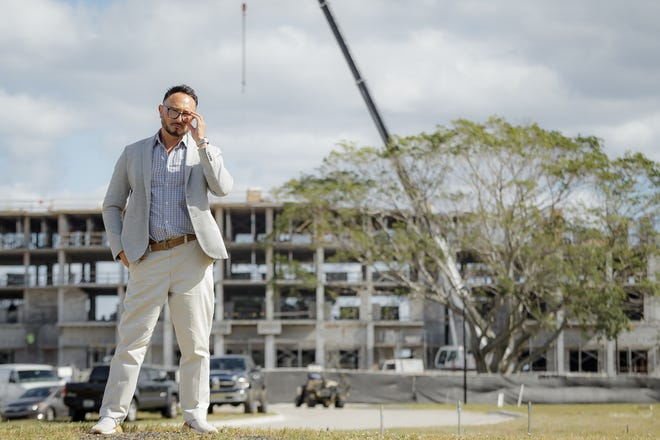 Sales executive of The Residences at Banyan Cay, Terii Bazley near the hotel construction on Dec. 3 in West Palm Beach.