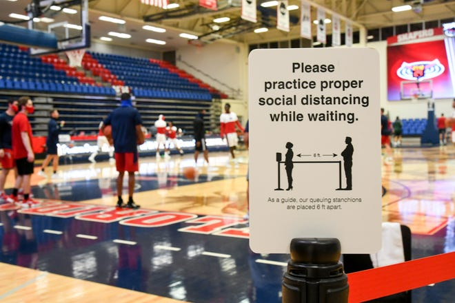 Social distancing signs at the Florida Atlantic Owls basketball game against the Florida National Conquistadors in Boca Raton on December 3, 2020. FAU's two-game road series at Marshall was postponed due to COVID-19 issues within the FAU program.