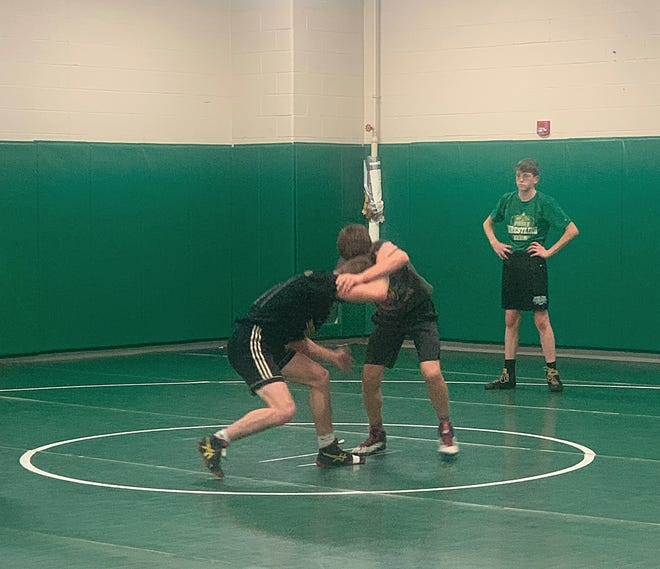 Dylan Pelland, PWC alum, home from Baker University leading practice, working with Taye Wilson.
