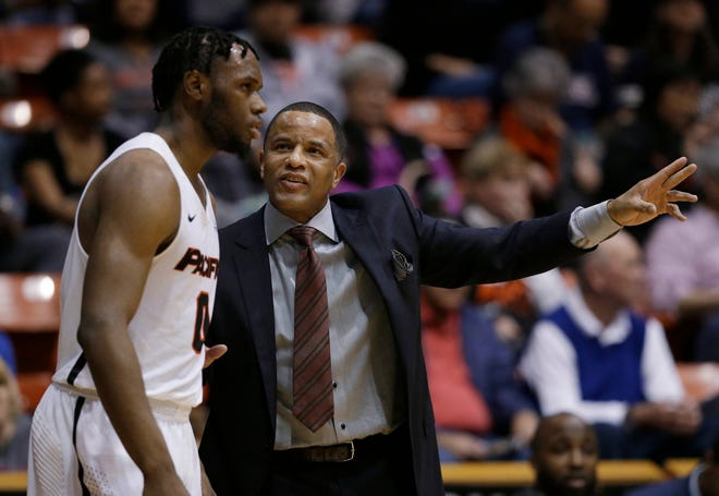 Pacific head coach Damon Stoudamire talks with Pacific guard Jahlil Tripp during the first half of an NCAA college basketball game against Gonzaga on Feb. 8, 2018, in Stockton.