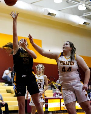 G-Men Jenna Smith drives into the lane against Sarah Neer of the Pirates in Ravenna on December 3, 2020.