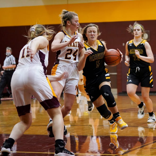 Garfield senior guard Grace Mills drives into the lane against Southeast's Olivia Neer and Reagan Pettigrew Dec. 3.
