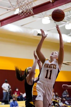 Southeast senior Olivia Neer attacks the basket and makes a layup against Garfield Dec. 3.