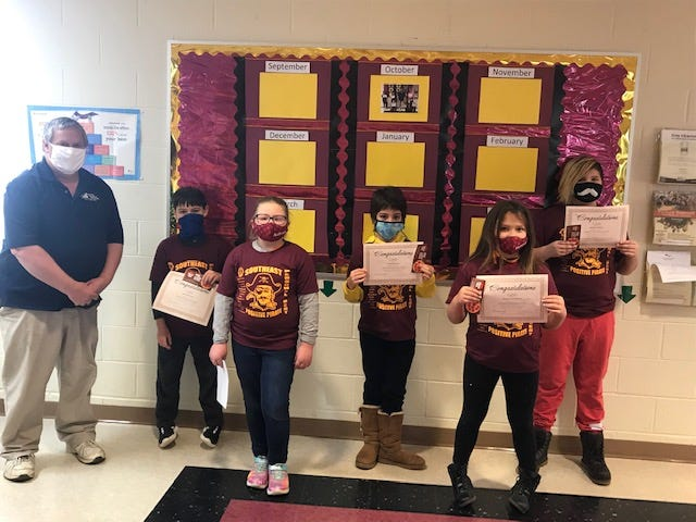 Southeast Intermediate School named itsPositive Pirates for the month of November.Front row are Aubree Ruggles and Payton Pendleton. Back row, from left are Lion's Club member Roger Mansfield, Landon Youel, Vayda Stelzer and Andrew Payne. Also honored was Harmony Mills.