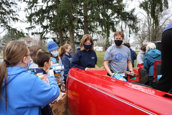 St. Joseph teacher Mark Vollmer and his leadership teams fill vehicles with donated items.