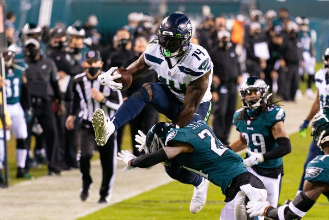 Seattle wide receiver DK Metcalf tries to leap over Philadelphia Eagles cornerback Darius Slay during the second quarter of Seattle's road win on Monday. Metcalf and the Seahawks host the New York Giants on Sunday.