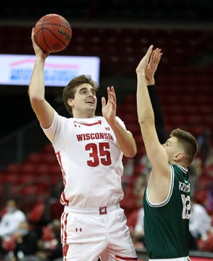 Nate Reuvers (35) leads No. 4 Wisconsin against Marquette on Friday.