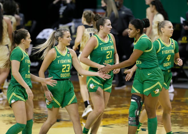 Oregon women basketball players including Taylor Chavez, left, Maddie Scherr, Erin Boley, Nyara Sabally and Jaz Shelley come together for a timeout during the first half against Colorado.