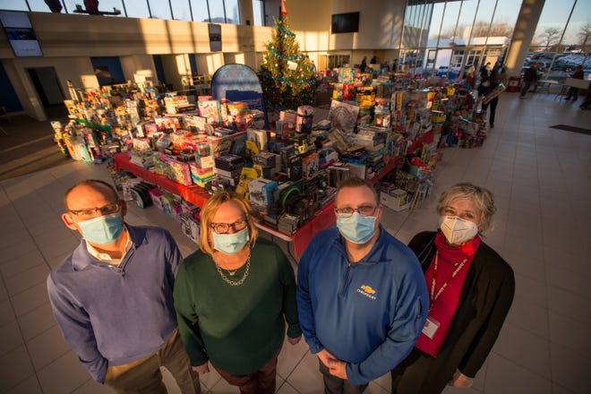 Patrick Bachrodt, from left, Rachel Bachrodt, Charlie Hansmeyer, all of Lou Bachrodt Auto Mall, and Nancy Jenkins, development director for The Salvation Army, show the thousands of gifts they collected during the 23rd annual toy drive at Lou Bachrodt Auto Mall on Friday, Dec. 4, 2020, in Rockford.