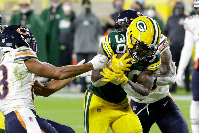 Green Bay Packers running back Jamaal Williams runs for a touchdown during the second half of Nov. 29 against the Chicago Bears in Green Bay, Wis. The Packers play the Philadelphia Eagles Sunday in Green Bay.