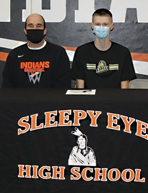 Sleepy Eye High School Activity Director Cory Haala and senior basketball player Kegan Heiderscheidt.