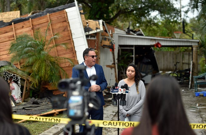 """Attorney C.J. Czaia and Karina Lopez speak Friday at a press conference about a gas explosion in December at Lopez's Bradenton home. Karina's 23-year-old brother, Adrian """"Junior"""" Lopez, diedJan. 13 at Largo Medical Center from injuries suffered during the explosion."""