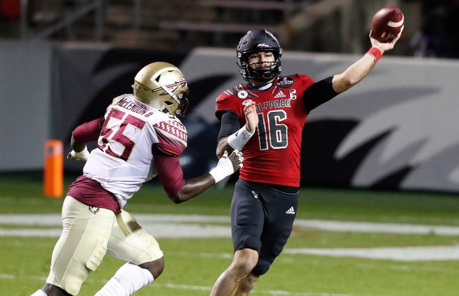 North Carolina State quarterback Bailey Hockman (16) is pressured by Florida State defensive end Derrick McLendon II (55) last month in Raleigh, N.C. The Wolfpack are among the teams that could play in the TaxSlayer Gator Bowl on Jan. 2. Ethan Hyman/Raleigh News & Observer