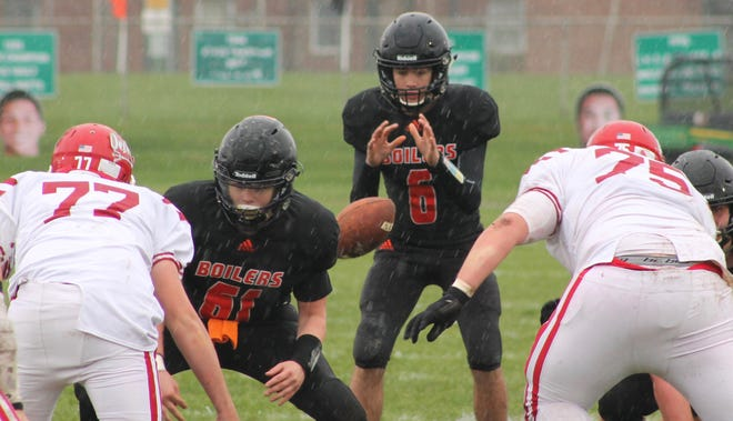 Kewanee High School quarterback Will Bruno (6) takes a snap during its 2019 regular-season finale against Hall on a rainy Saturday afternoon on Nov. 12, 2019. Kewanee finalized its fall 2021 football schedule.